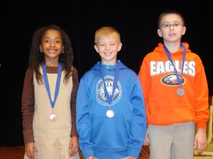 2013 SCA Spelling Bee Winners, 4th graders Kyler Simmons (3rd place), Nate Bartlett (1st place), and Jacob Martinez (2nd place).