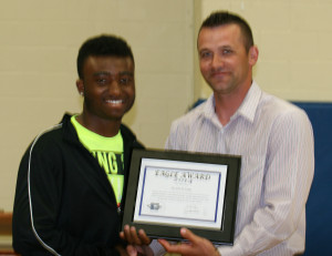 Pictured here are Taurin Hughes and Summit Christian Academy Athletic Director Jake Kates.