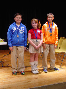 SCA 2-14 Spelling Bee Winners, left to right: 5th grader Zach Chinnery (3rd place), 3rd grader Abigayle Cook (2nd place) ,and 5th grader Jacob Martinez (1st place).