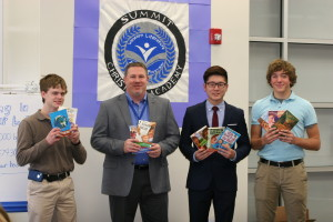 SCA students send books to chinese school