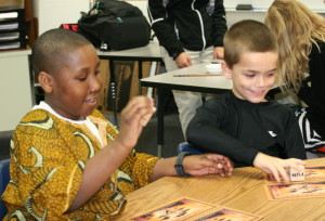 "SCA 4th grader Joshua Gardner and 2nd grader and Mason Kates play an African game in the ""Games Around the World"" section of the 3rd Annual Summit Christian Academy International Festival. Over 500 were in attendance at the event that had food and cuisine from across the globe, as well as performances ranging from Yizu Folk Dance to a Polynesian Dance."