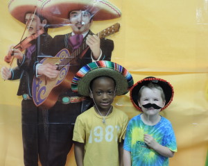 "SCA Early Education students Brevin Ferguson and Ethan Sanders say ""queso!"" at the Poncho Photo Booth during SCA's Cinco De Mayo Fiesta."