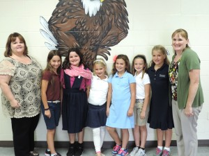 SCA Academic Dean and Elementary Principal Kimberlee Gill (far left) and Vice-Principal Charissa Sanders (far right) with third grade Reader Leaders (left to right) Lucie Epema, Renee Chapman, Sophie Cooke, Charli Hinton, Brynne McFarland, and Emma Coats.
