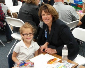 SCA Head of School Linda Harrelson's favorite part of Grandparents' Day is sharing it with two of her own grandchildren who attend SCA.  Pictured here, she is making a graph with first grade granddaughter Eliana Harrelson.