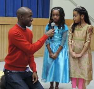 Guest speaker & local author Keion Jackson, author of Because Jesus, was part of SCA's annual D.E.A.R. day. Pictured here Keion (far left) is encouraging SCA Kindergarten students Gabrielle Moses and Jadyn McIntosh to discuss their favorite literary characters during the all-school assembly in which Keion Jackson was the keynote speaker.