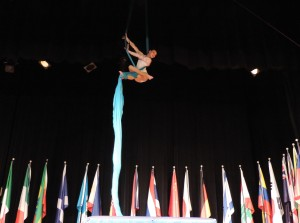 SCA sixth grade student Jordan Drum wowed the audience as she climbed, wrapped and dropped in her aerial silk performance on the stage at the SCA International Festival.
