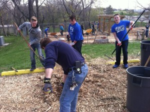 SCA eighth grade students Sam Espey, Jacob Walden, and Tristan Wells help improve a community garden recently as the SCA Junior High spent a day away from the classroom and out in the community serving.